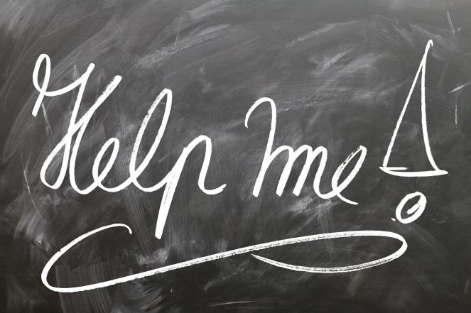 """the words """"help me"""" written on a chalkboard"""